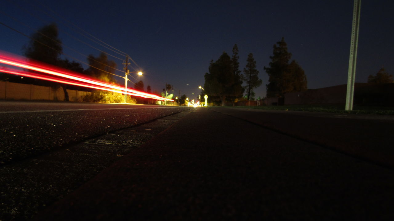 night, illuminated, speed, transportation, motion, long exposure, blurred motion, light trail, road, outdoors, street light, sky, no people, railroad track, clear sky, high street