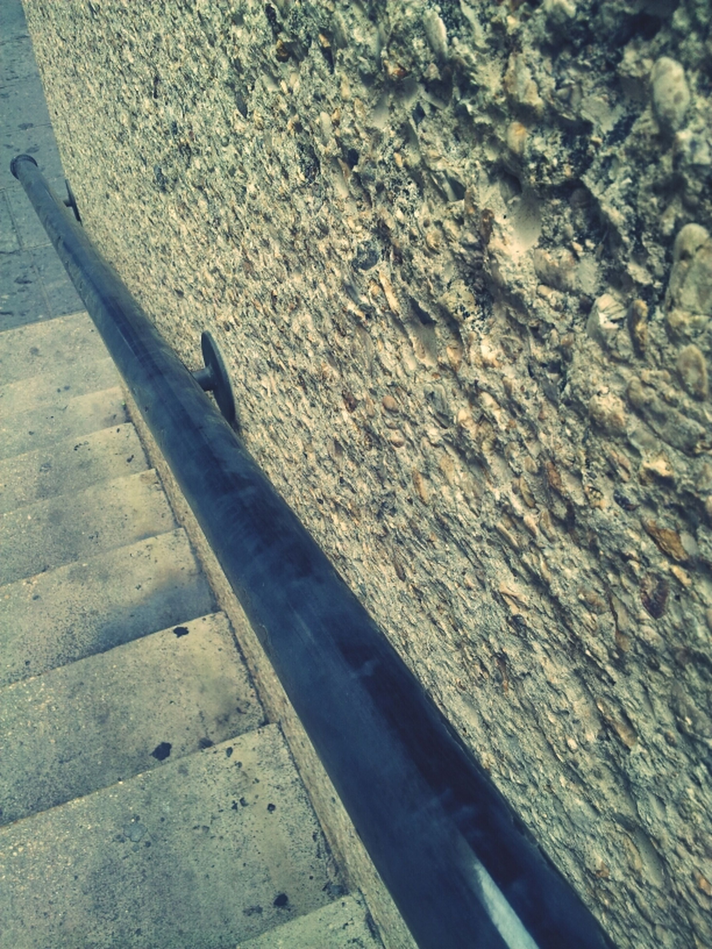 high angle view, shadow, sunlight, day, street, road, outdoors, textured, close-up, no people, asphalt, concrete, transportation, part of, sidewalk, elevated view, railing, cropped, nature, footpath