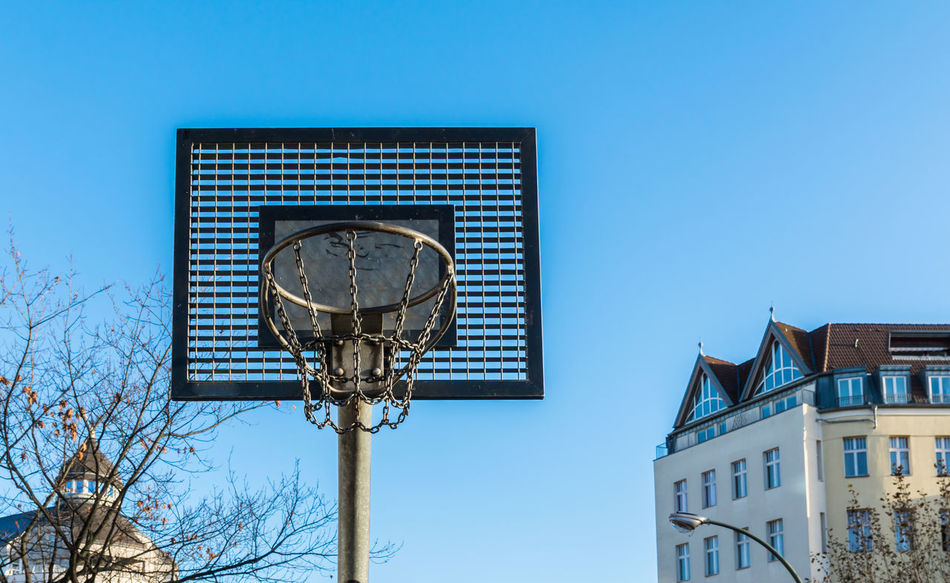 Basket Basketball Basketball Basket Basketball Hoop Basketballkorb Building Exterior City Day Low Angle View Nature No People Outdoors Sky Sport Sport In The City Tree