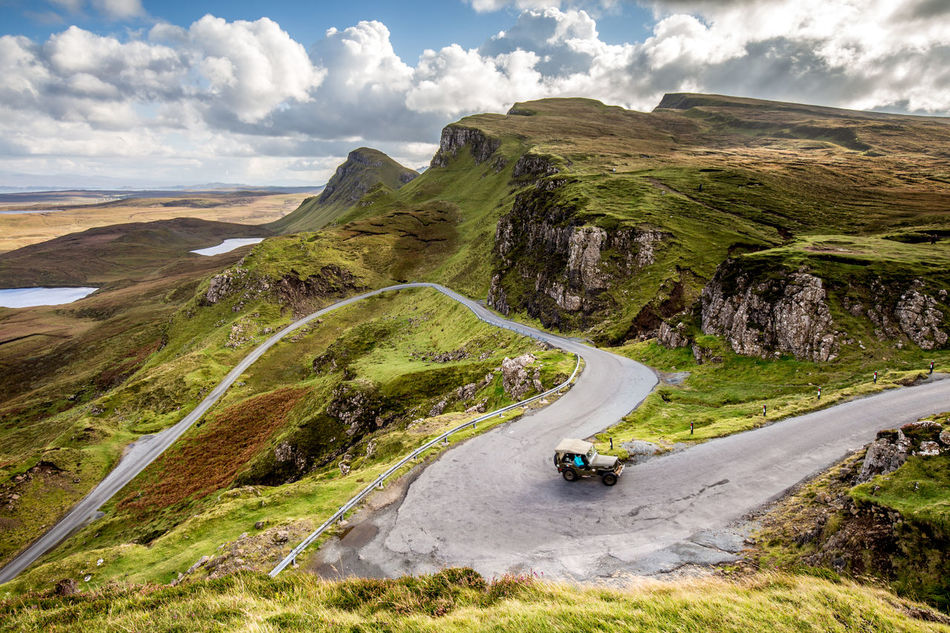 Adventure Beauty In Nature Bicycle Cloud - Sky Curve Day Jeep Land Vehicle Landscape Motorcycle Mountain Mountain Range Mountain Road Nature No People Outdoors Quiraing Road Scenics Scotland Sky Skye Transportation Water Winding Road
