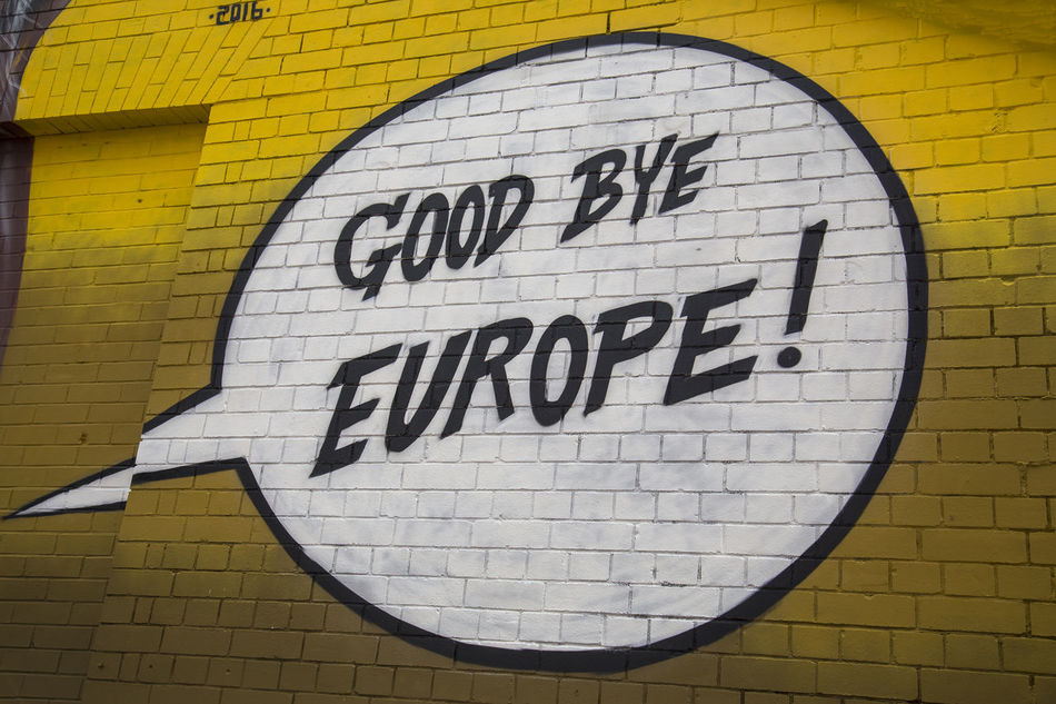 A graffiti slogan spray painted on a wall saying Good Bye europe Brexit Brick Wall Europe Goodbye Graffiti Message Wall