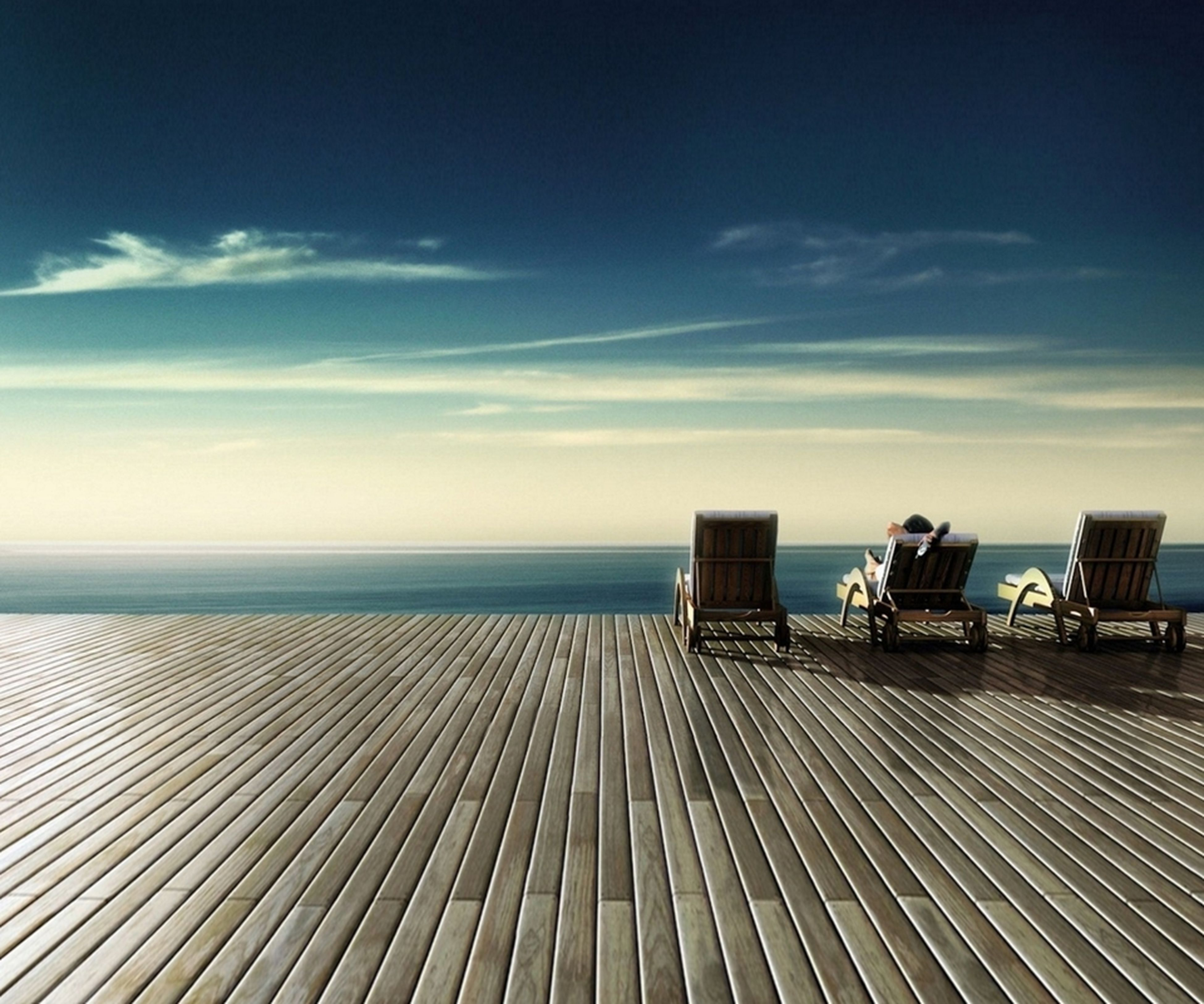 sea, horizon over water, beach, sky, tranquil scene, tranquility, water, sand, scenics, shore, nature, beauty in nature, pier, the way forward, cloud - sky, wood - material, boardwalk, blue, cloud, idyllic