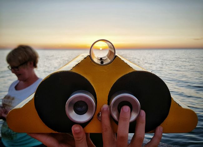 Focus On The Sun Sunset Watching The Sunset Enjoying The Sun Mother Nature Relaxing Holidays Seaside Enjoying Life Beauty In Nature Summertime Baltic Sea Ostsee Seashore Binoculars Two Are Better Than One Hands
