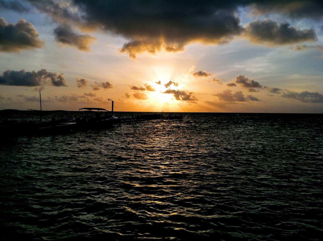 Amazing Sunrise #belize #caribbeansea #Sunrise #sunset #sun #clouds #skylovers #sky #nature #beautifulinnature #naturalbeauty #photography #landscape Beauty In Nature Cloud - Sky Horizon Over Water Idyllic Majestic Nautical Vessel Ocean Rippled Seascape Sun Tranquil Scene Waterfront