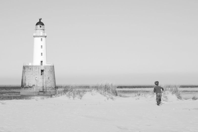 Rattray Head Lighthouse Aberdeenshire Architecture Beach Boy Running Child Child Running Childhood Clear Sky Day Direction Epic Freedom Guidance Lighthouse Nature Outdoors Scenics Scotland Sea Tall - High Tranquil Scene Tranquility Copy Space Copyspace