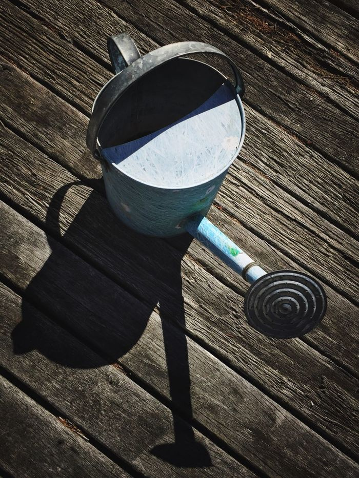 Old Watering Cans Shadows On The Floor Shadows Timber Floor Timber Deck