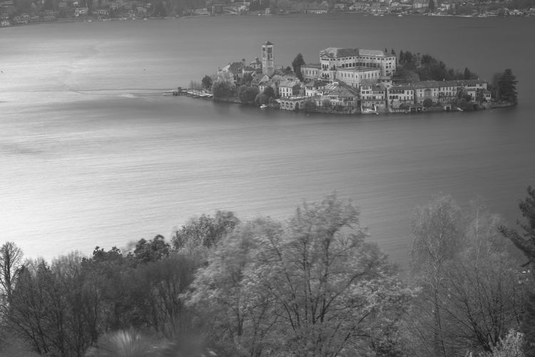 Orta San Giulio, Piedmont, Italy. Views of St. Julius' Island and its cloistered monastery, in the middle of Lake Orta, taken from nearby Sacro Monte. Borghitalia Calm Clouds Historic History Island Italy Lake Lake View Lakeside Landscape Landscapes With WhiteWall Monastery Old Buildings Old Village Orta  Orta S.Giulio Orta San Giulio Piedmont Sigthtseeing Tranquil Scene Tranquility Travel Water