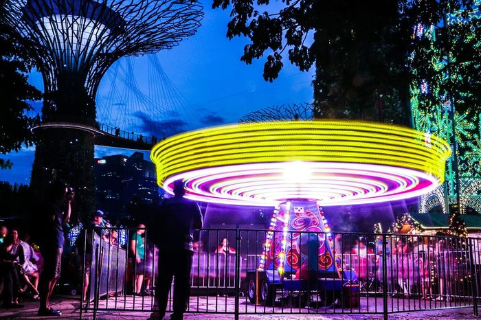 Hypnotic Singapore Igsg Instasg Canonphotography Canon 70d Canon Canonimagingacademy Canonimagingasia Canoneos Canonasia CanonSG Lightroom AdobeLightroom Arts Culture And Entertainment Night Amusement Park Enjoyment Amusement Park Ride Fun Multi Colored Outdoors Crowd Illuminated People Carousel Sky