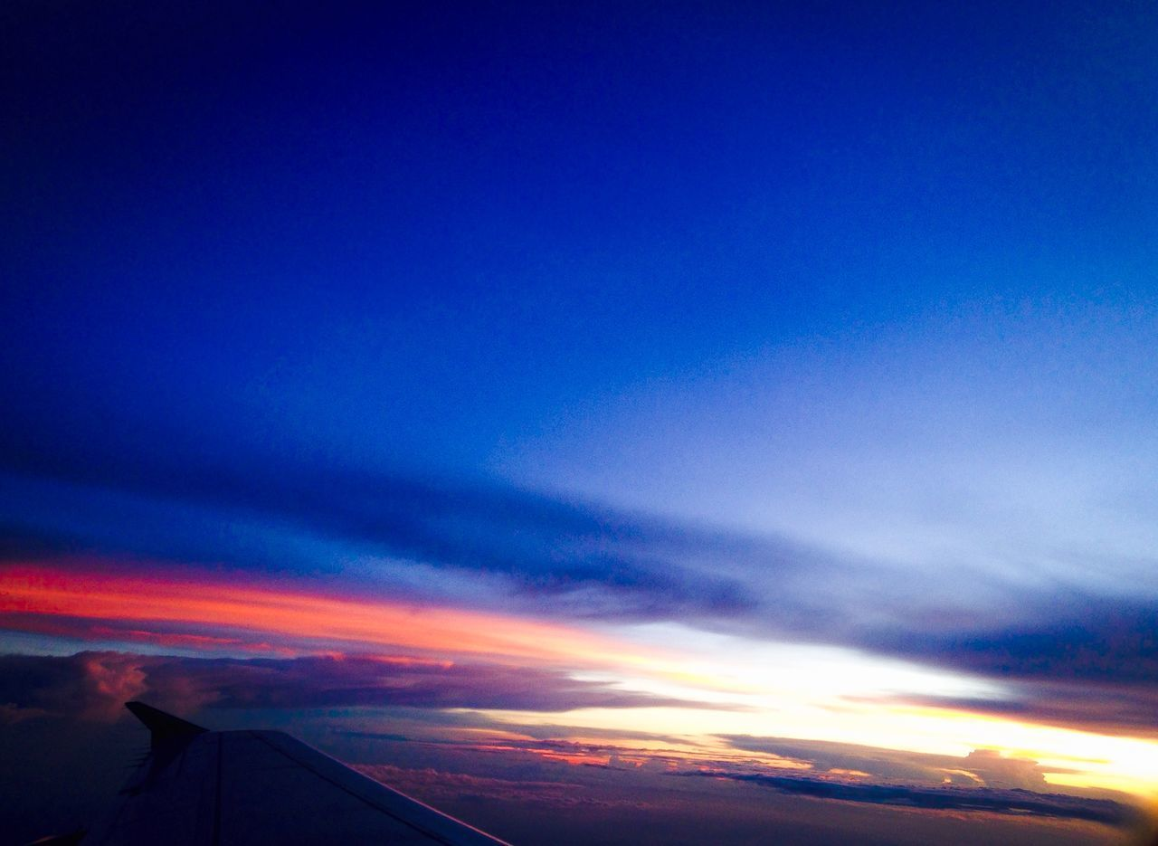 sunset, beauty in nature, sky, nature, scenics, cloud - sky, blue, tranquil scene, majestic, tranquility, no people, outdoors, airplane, airplane wing, day