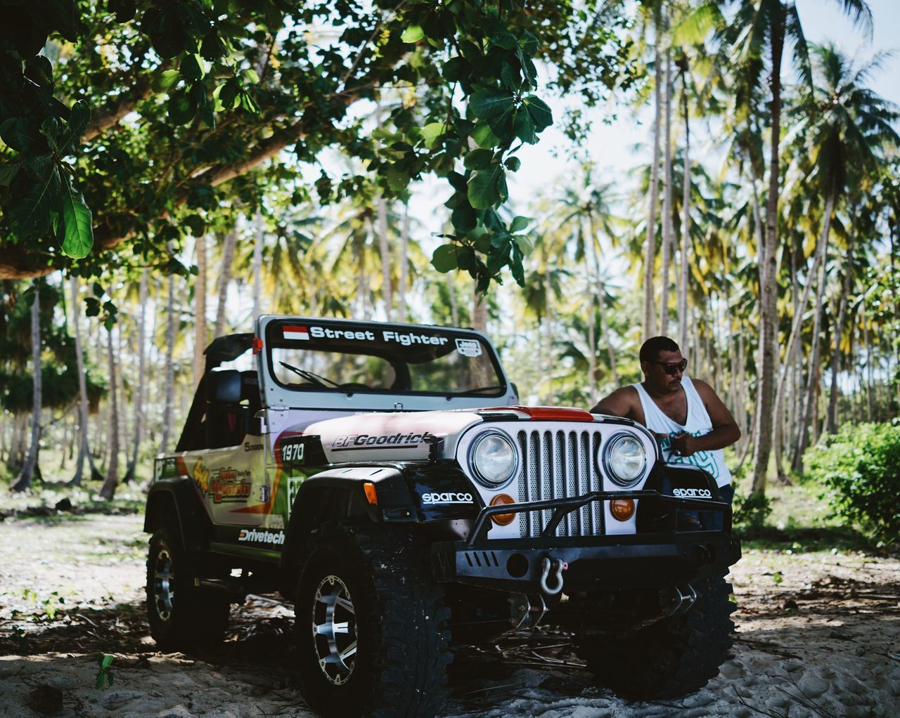 ASIA Atv Cool Guy Day INDONESIA Jeep Land Vehicle Maluku  Man Mode Of Transport Moluccas Morotaiisland Palm Trees Posing Shadow Transportation Travel Tree Tropical The Portraitist - 2017 EyeEm Awards