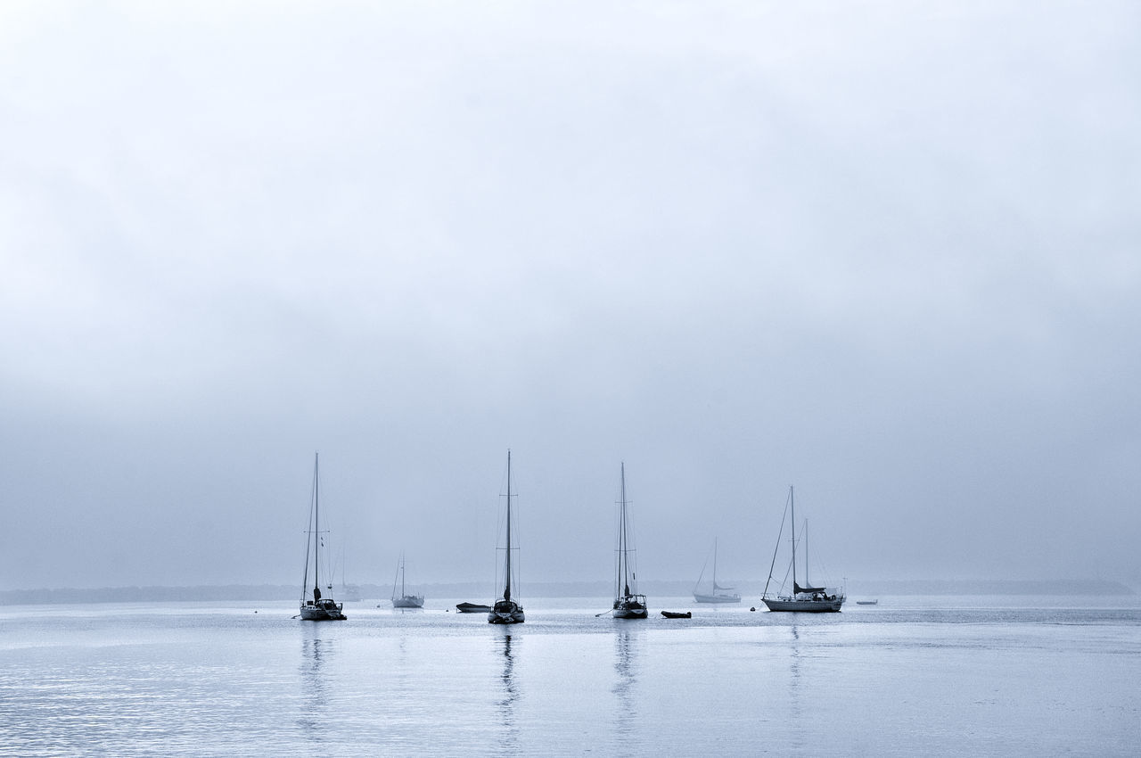 Boats On Sea Against Sky