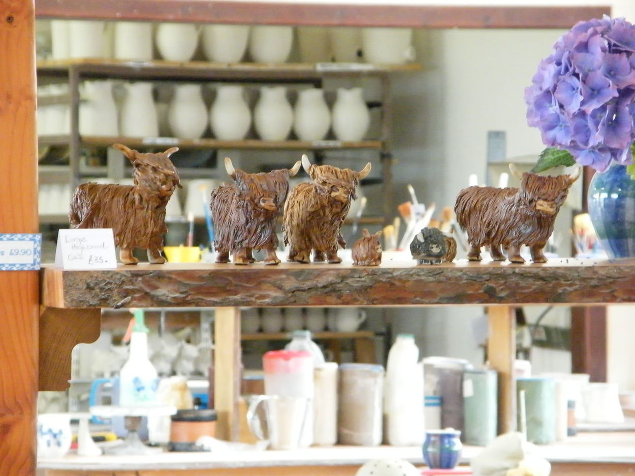 Animal Themes Art Art And Craft Cattle Ceramics Day Domestic Animals For Sale Highland Cattle Holiday Souvenirs Indoors  Mammal No People Pottery Shelf Variation