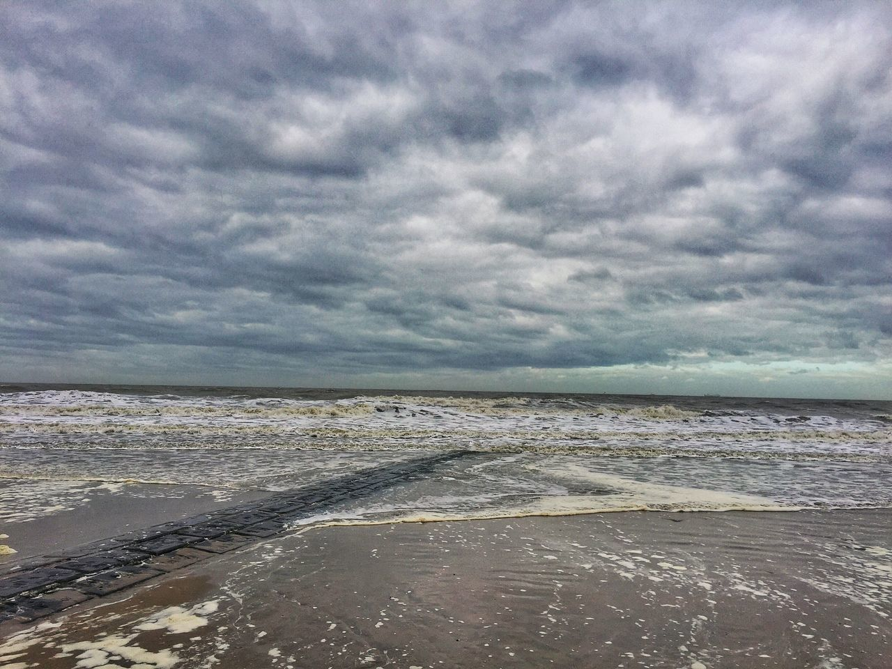 sea, sky, cloud - sky, beauty in nature, water, scenics, tranquil scene, tranquility, nature, beach, horizon over water, no people, day, outdoors, wave, sand