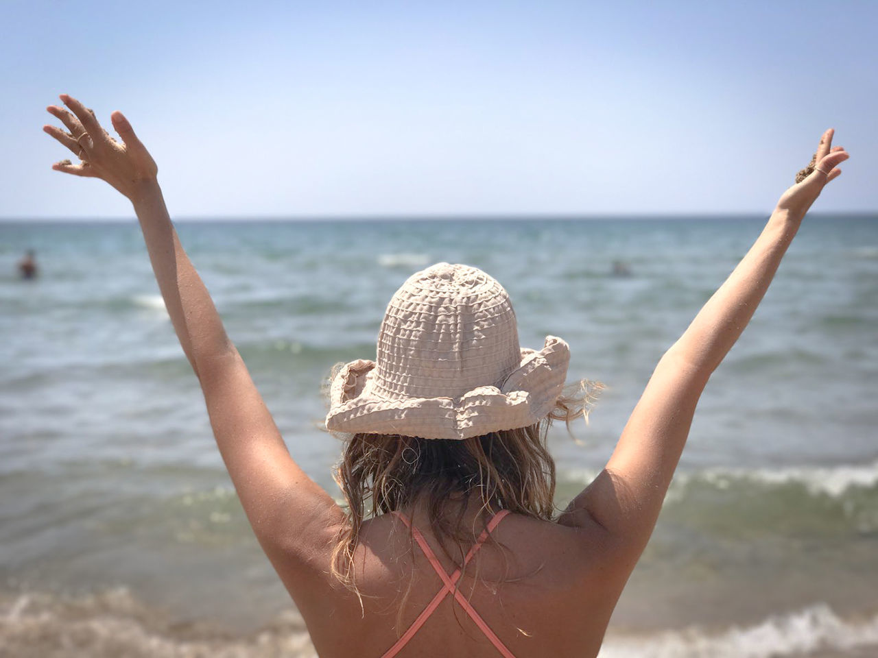Beach Beauty In Nature Bikini Day Girl Horizon Over Water Leisure Activity Lifestyles Long Hair Nature One Person People Raised Hands Real People Rear View Sand Sea Sky Summer Sunlight Vacations Water Young Adult Young Women