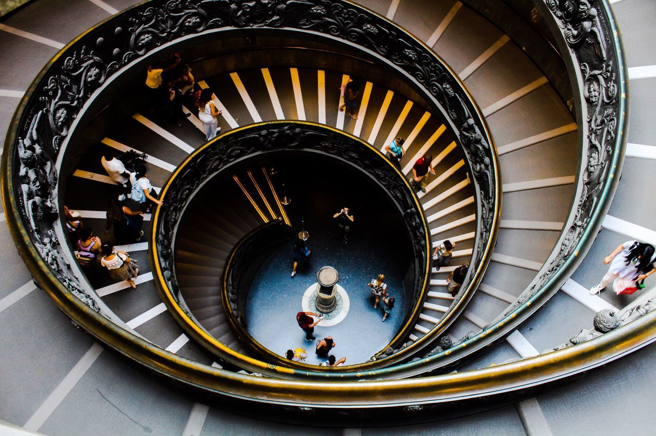 steps and staircases, staircase, high angle view, railing, steps, architecture, stairs, spiral, built structure, large group of people, men, indoors, day, people