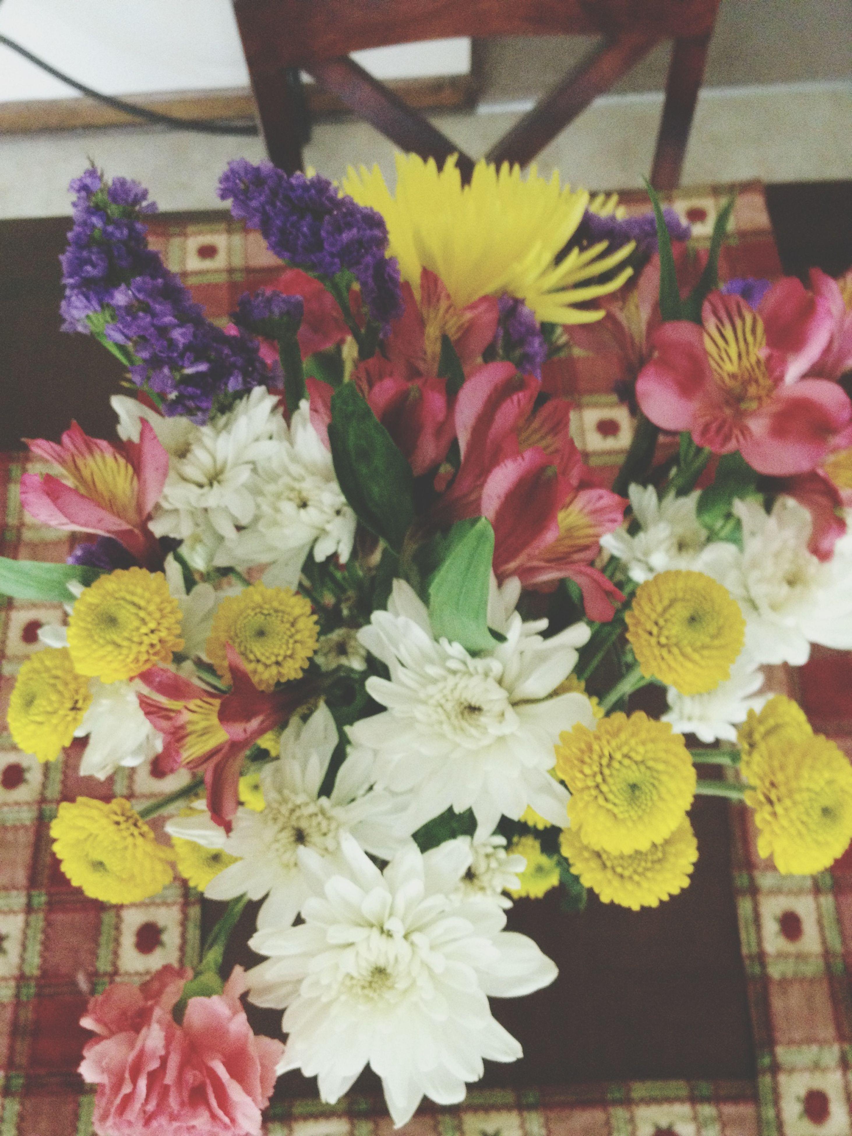 flower, freshness, fragility, petal, indoors, bouquet, variation, flower head, multi colored, bunch of flowers, flower arrangement, abundance, decoration, beauty in nature, vase, high angle view, arrangement, nature, close-up, blooming