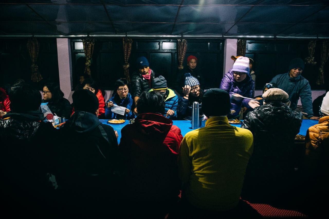 A 10-Day Trekking Adventure into Nepal's Annapurna Range Adventure Annapurna Audience Crowd Hike Hiking Himalayan Himalayas Indoors  Journey Large Group Of People Men Mountain Mountain Range Mountaineering Mountains Mountainscape Nepal Nepal Travel Real People Standing Travel Trekking Watching Women