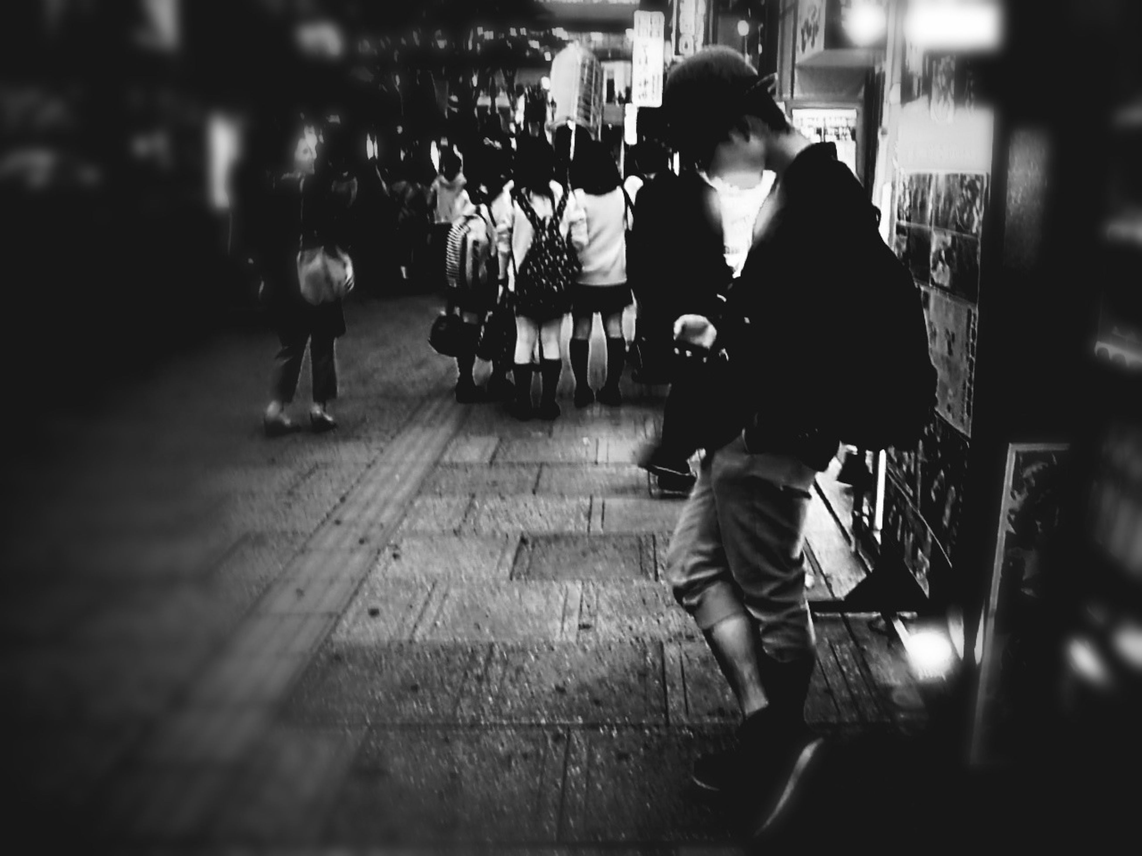 full length, lifestyles, casual clothing, leisure activity, childhood, rear view, indoors, night, boys, walking, focus on foreground, selective focus, girls, men, standing, elementary age, illuminated