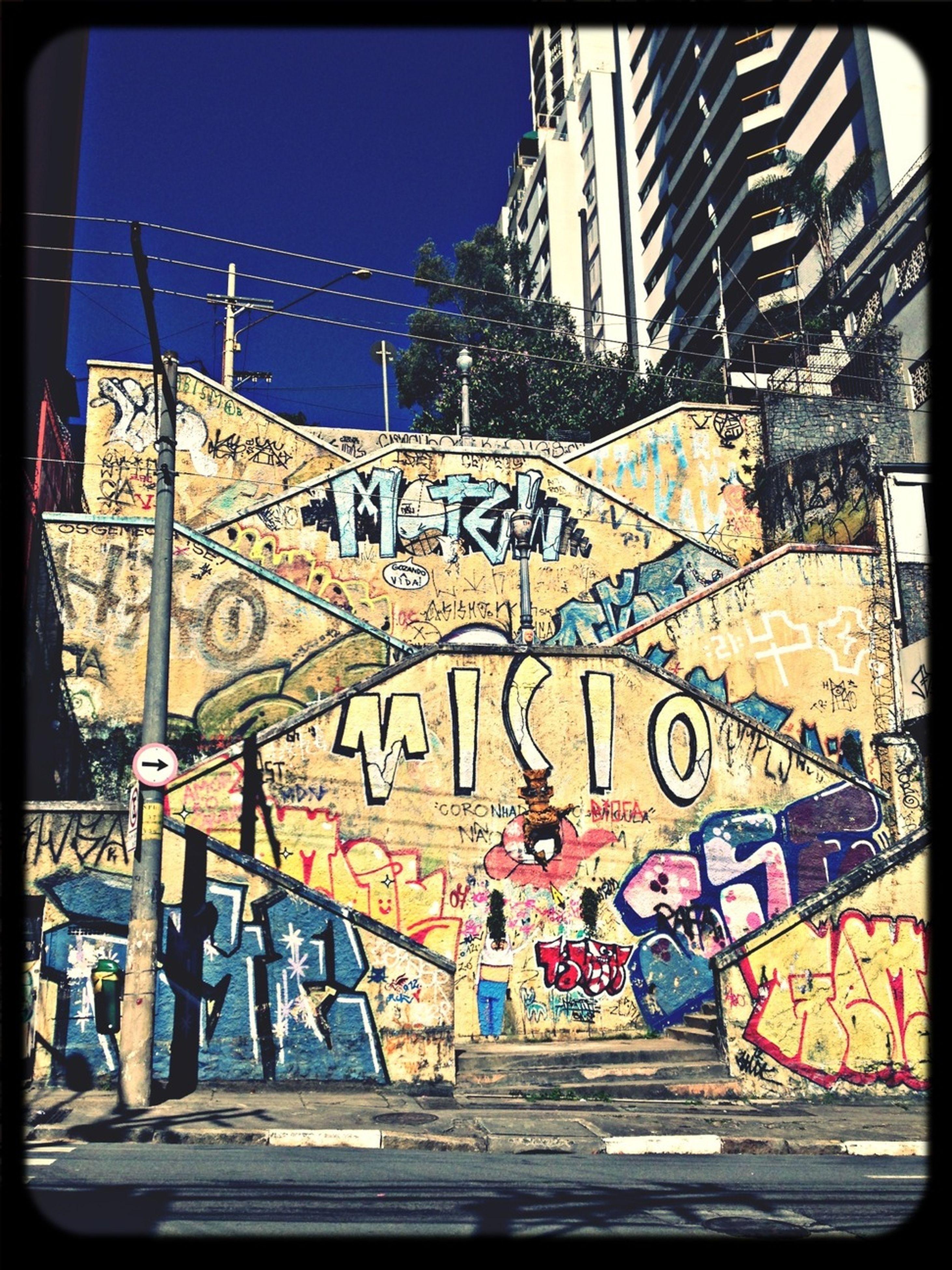 graffiti, built structure, architecture, building exterior, text, transfer print, western script, art, auto post production filter, creativity, art and craft, communication, wall - building feature, street art, city, vandalism, building, outdoors, day, sunlight