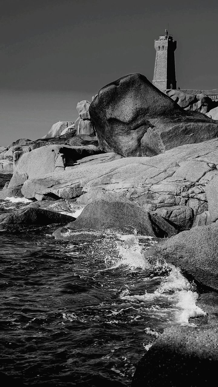rock - object, water, no people, sea, nature, outdoors, architecture, day, building exterior, beauty in nature, lighthouse, sky, clear sky, wave