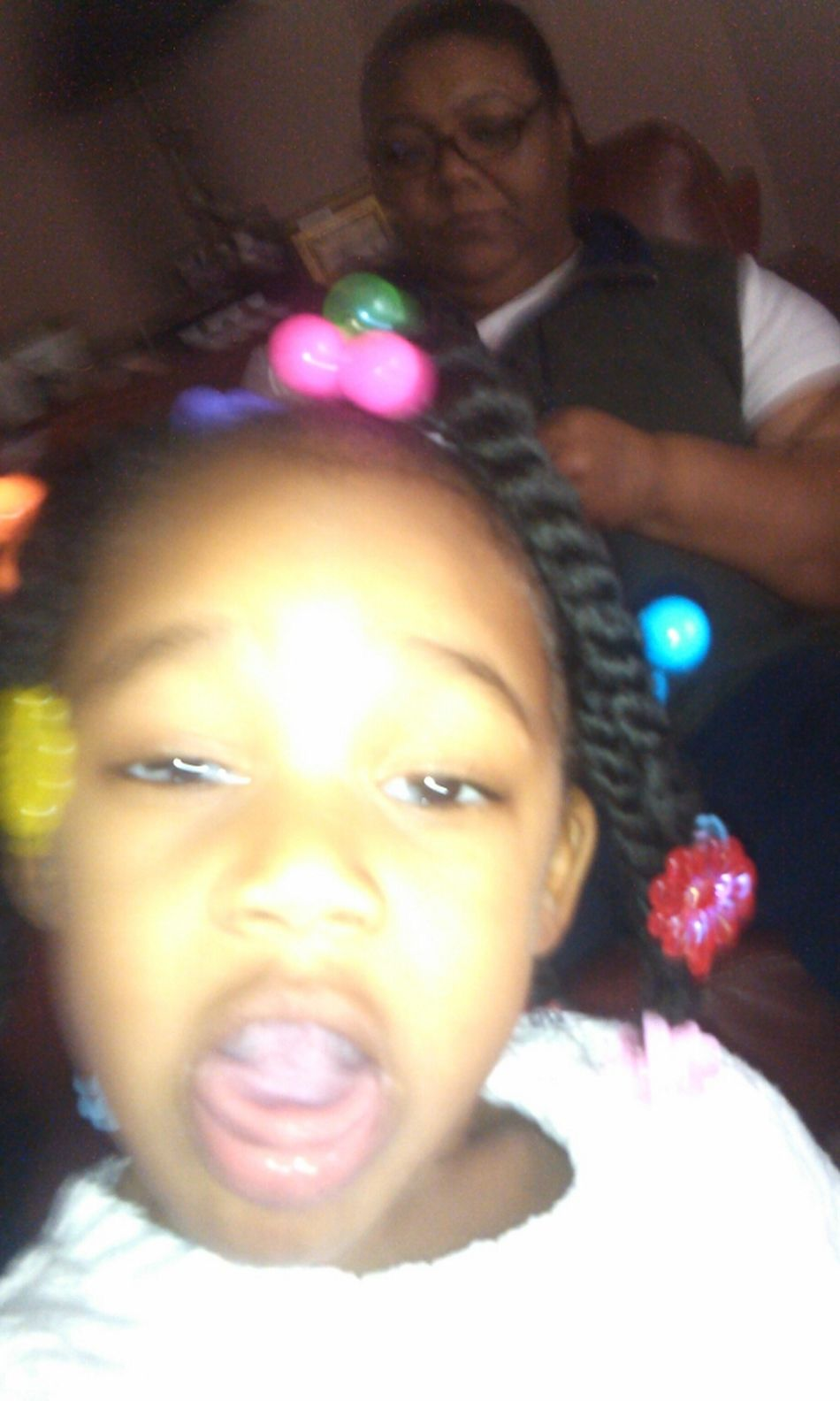 thinking shes grown and takeing pictures on my phone smh shes a mess but gotta love her...