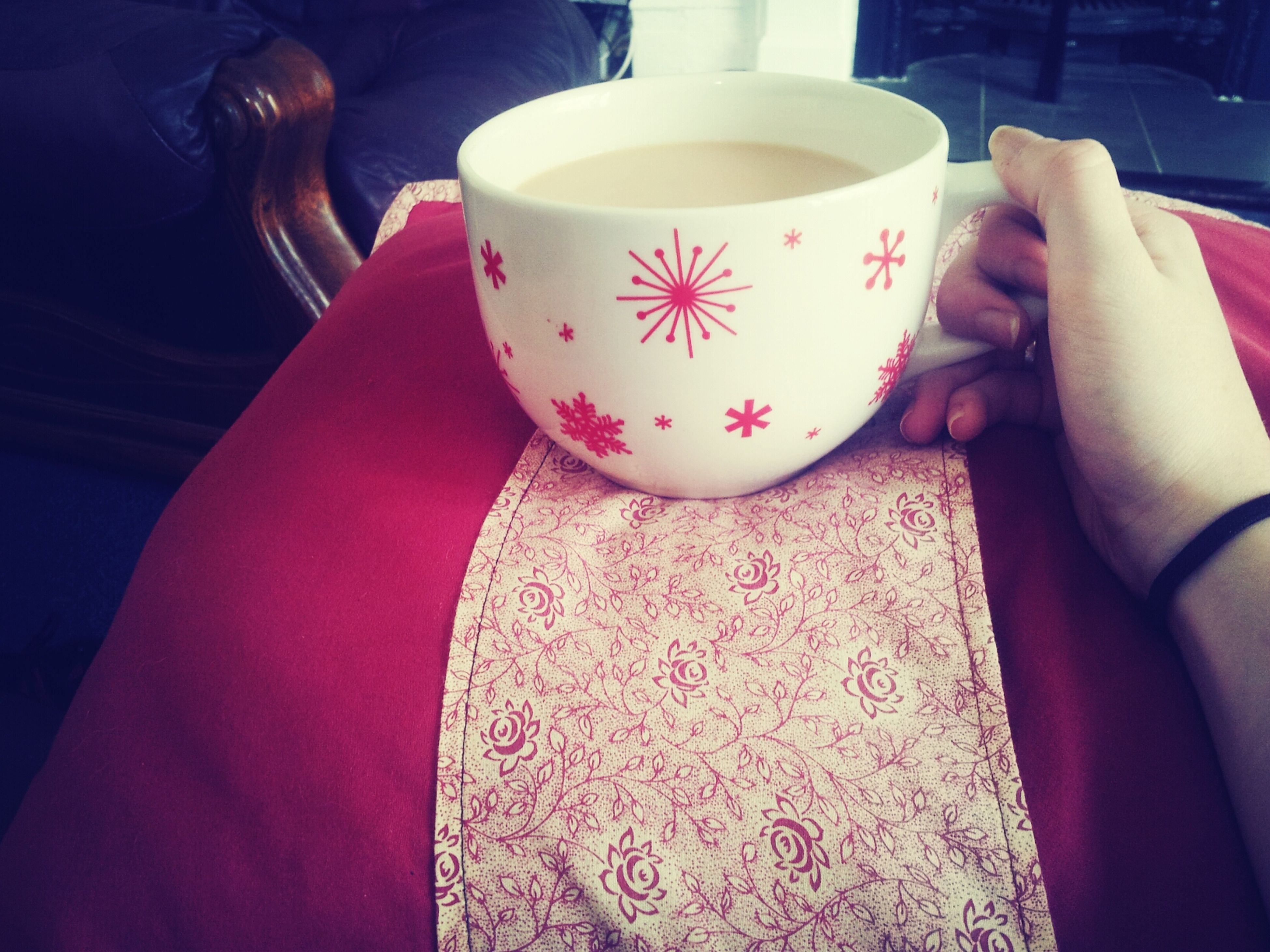 indoors, table, high angle view, floral pattern, creativity, art, home interior, art and craft, food and drink, person, animal representation, decoration, lifestyles, coffee cup, design, childhood, still life