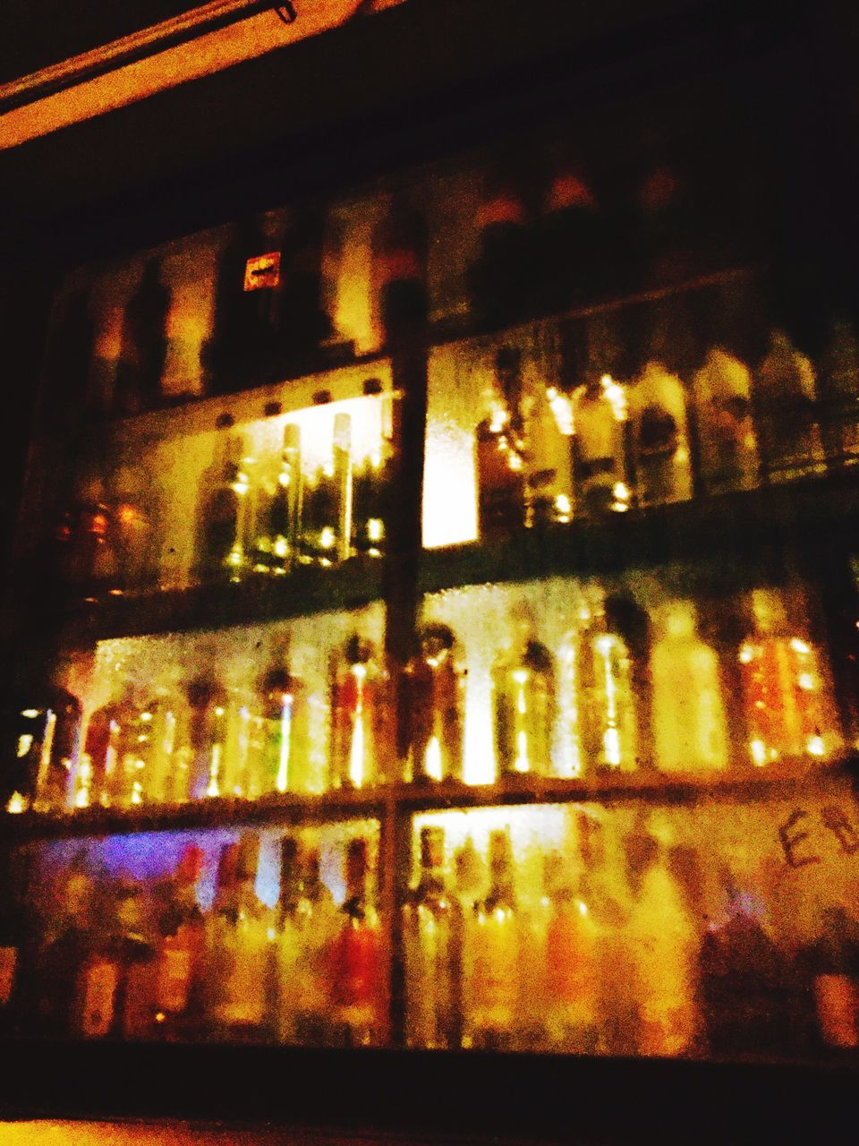 illuminated, night, alcohol, indoors, bottle, no people, wine, food and drink, shelf, close-up, drink, nightlife, architecture