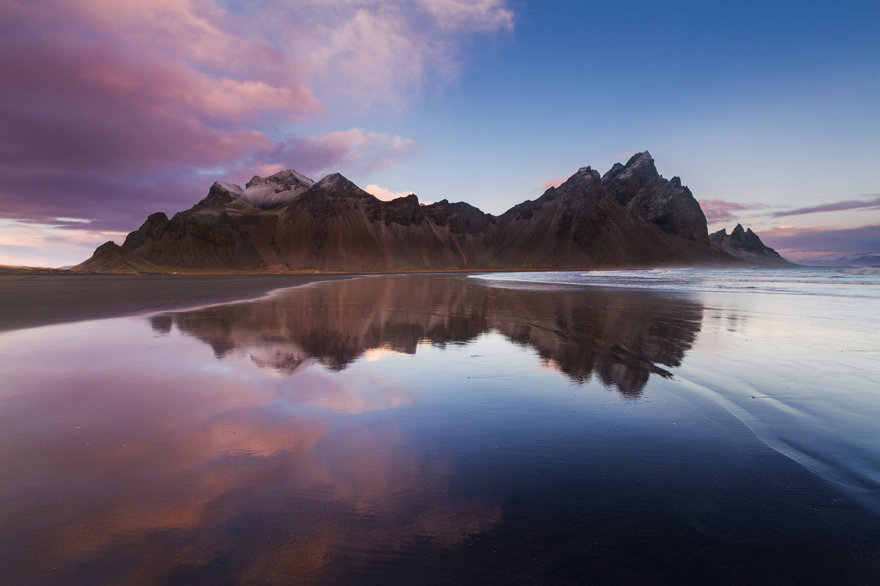 Sunrise in Stokksnes Beach Beachphotography Beauty In Nature Black Sand Beach Clear Water Cloud - Sky Clouds Day Iceland Mountain Mountain Range Nature No People Outdoors Reflection Sand Scenics Sea Sky Stokksnes Sunrise Tranquil Scene Tranquility Water Waterfront