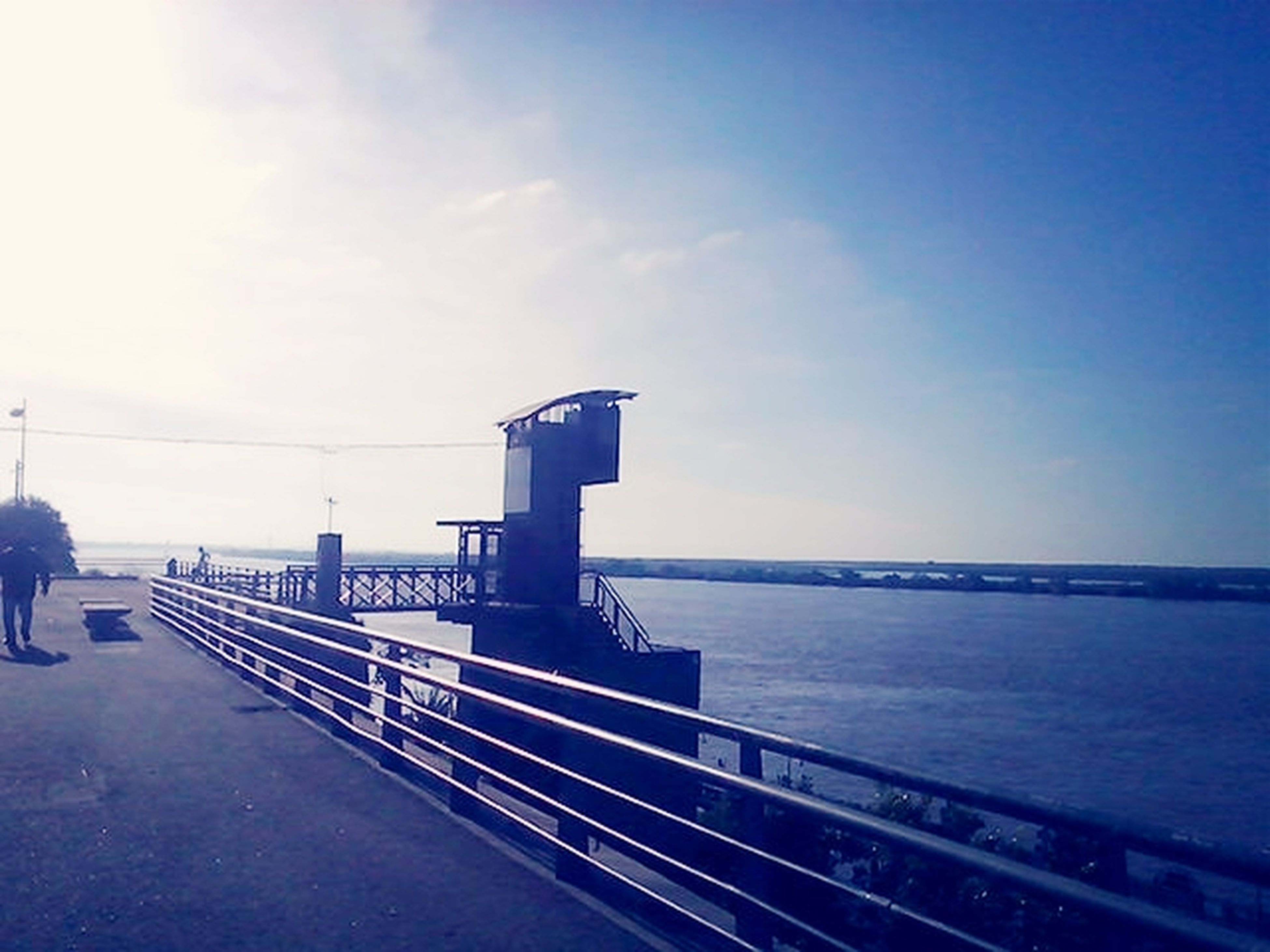 sea, railing, water, horizon over water, sky, pier, tranquility, tranquil scene, built structure, scenics, blue, nature, beauty in nature, the way forward, architecture, outdoors, calm, idyllic, day, jetty