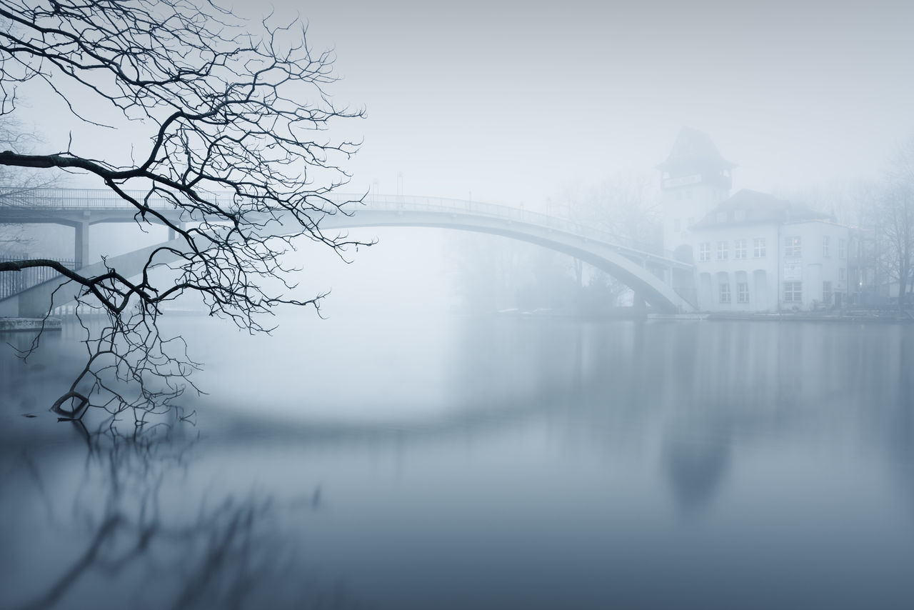 Isle of Youth at Berlin Treptower Park on a foggy day Architecture Bare Tree Berlin Branch Bridge - Man Made Structure City Cityscape Day Fine Art Fog Insel Der Jugend Long Exposure Muted Colors Nature No People Outdoors Philipp Dase Reflection River Sky Tranquility Travel Destinations Tree Water Winter