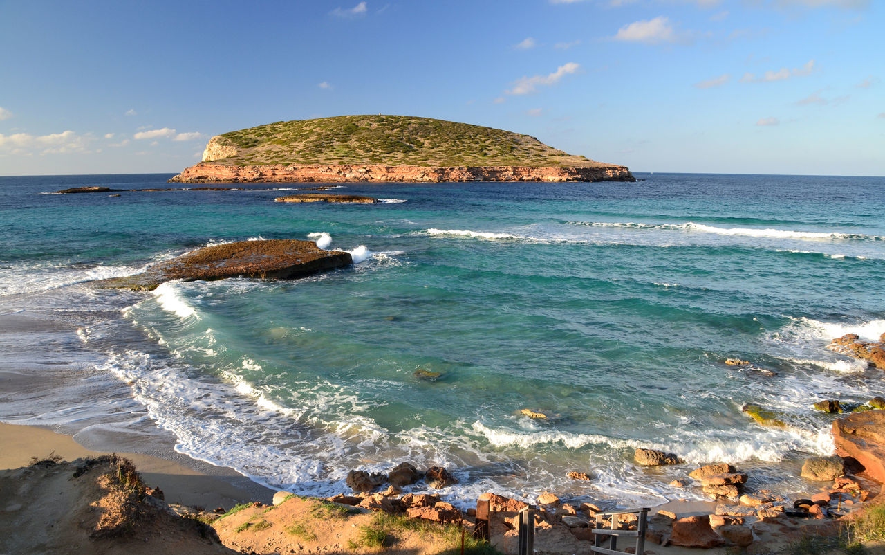 View of Cala Comte Beach in Ibiza, Spain Balearic Islands Beach Blue Cala Comte Horizon Over Water Ibiza Illes Balears Island Islas Baleares Landscape Mediterranean  Nature Ocean Outdoors Picturesque Rocks Scenics Sea Sea View Seaside Tourism Travel Turquoise Water Wave
