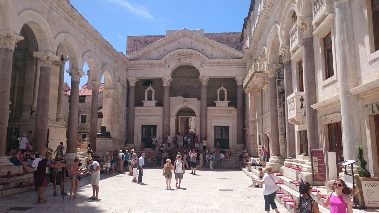 large group of people, architecture, real people, built structure, architectural column, tourism, building exterior, leisure activity, lifestyles, history, travel destinations, men, sunlight, day, vacations, women, outdoors, sky, people
