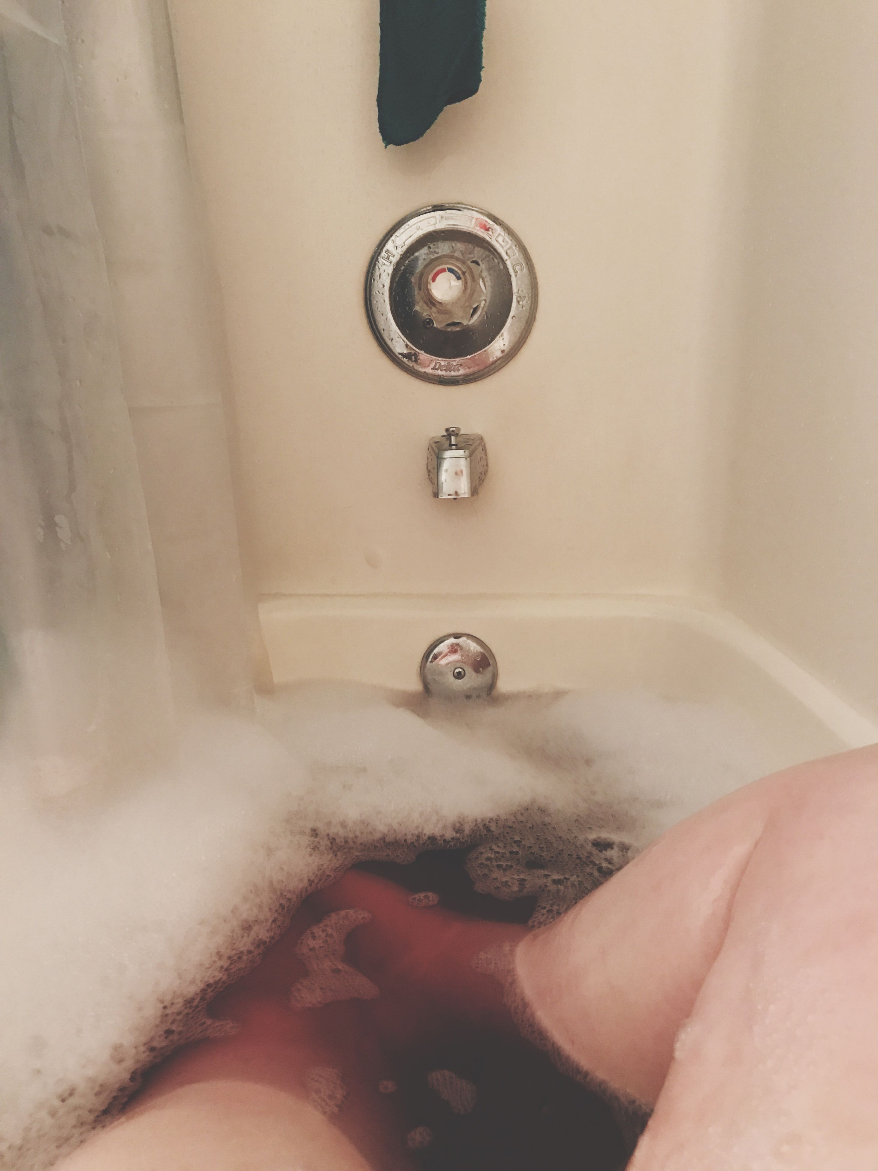 one person, indoors, human body part, real people, bathroom, domestic bathroom, close-up, domestic room, cleaning, bathtub, home interior, human leg, hygiene, human skin, human hand, adults only, adult, people, day