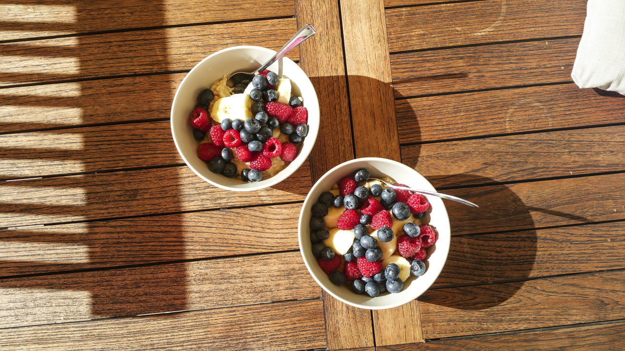 bowl, blueberry, table, fruit, food and drink, raspberry, freshness, wood - material, high angle view, cherry, breakfast, day, food, grape, healthy eating, indoors, no people, ready-to-eat, black olive