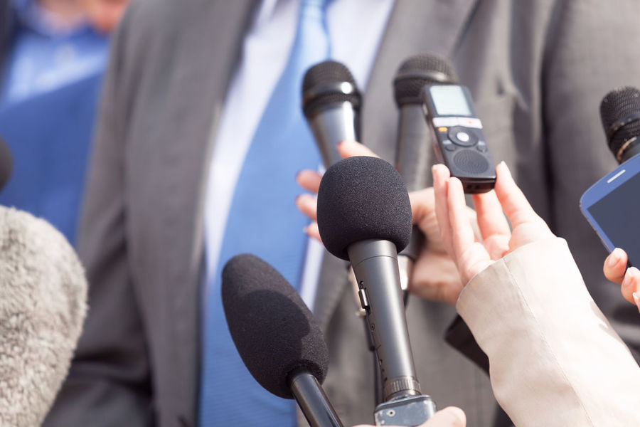 Media interview. News conference. Journalism. Business Event Journalist Politics Reporting Answering Broadcasting Business Person Communication Human Hand Information Journalism Journalist Media Media Interview Microphone News People Politician Press Conference Public Publicity Report Reporter Speaking