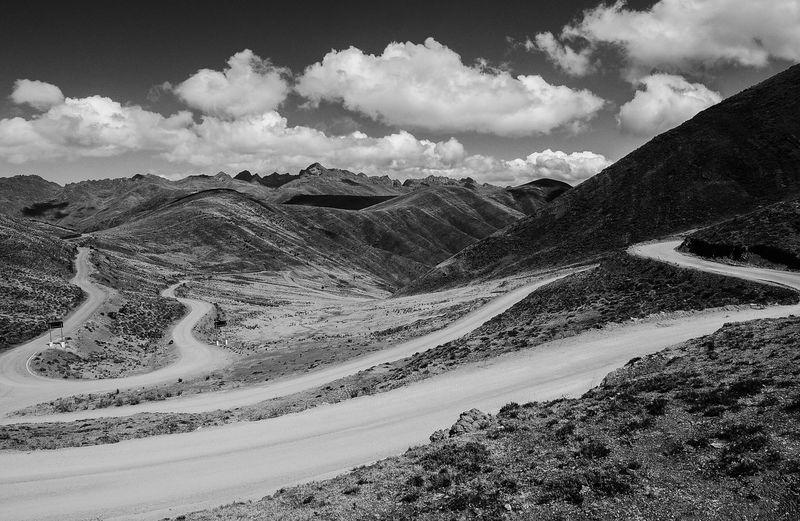 Winding road Landscape Cloud - Sky Mountain Cordillera De Los Andes Chicarhuapunta Road Mountain Road 4314m Pamparomas Ancash Peru Andes Landscape Photography Blackandwhite Pueblo Libre CordilleraNegra Mountain Range