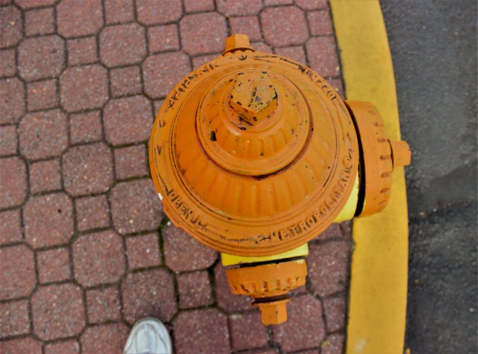 Orange Fire Hydrant Bricks Close-up Day Fire Hydrant High Angle View No People Outdoors Sidewalk Streetphotography Yellow