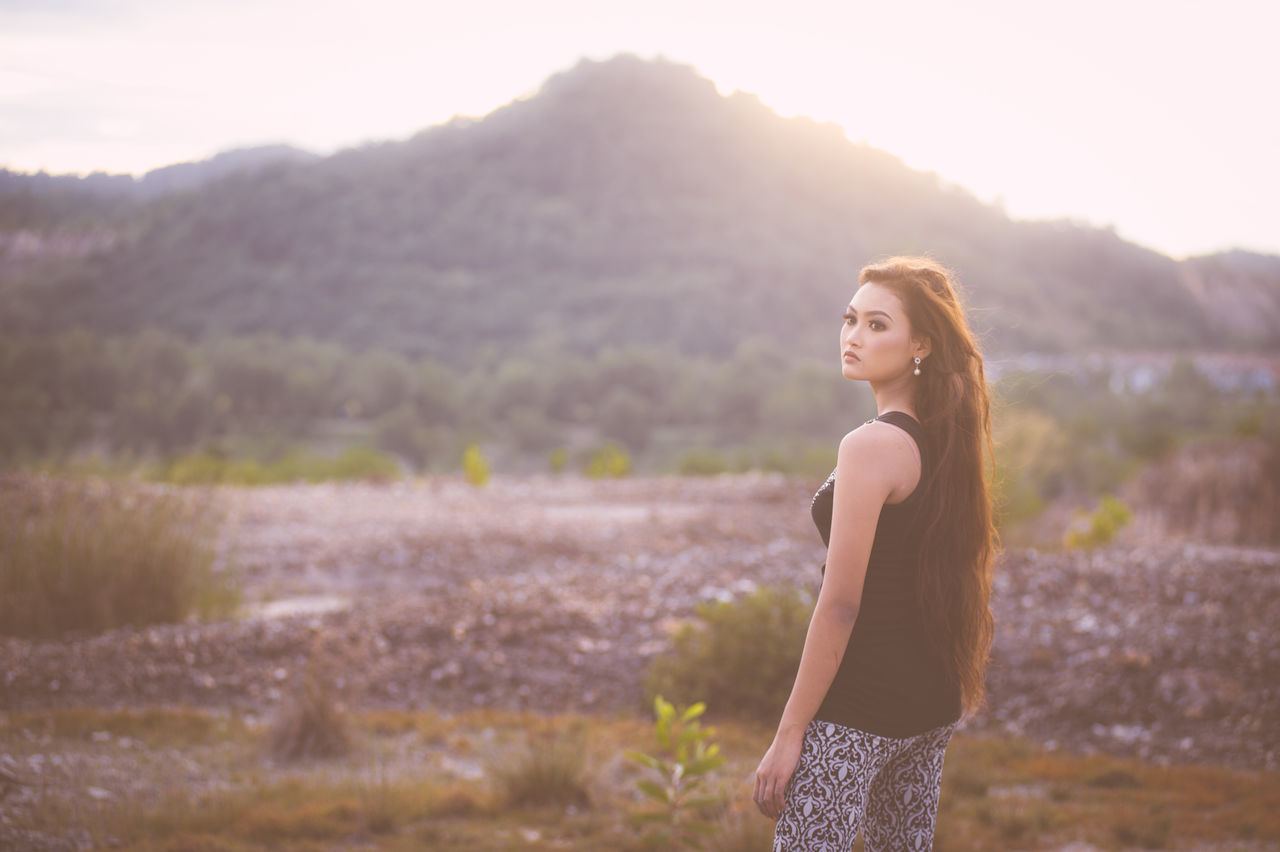 Abdomen Adult Adults Only Beautiful People Beautiful Woman Beauty Beauty In Nature Day Happiness Landscape Nature One Person One Woman Only One Young Woman Only Only Women Outdoors People Portrait Smiling Standing Sunlight Sunset Young Adult Young Women
