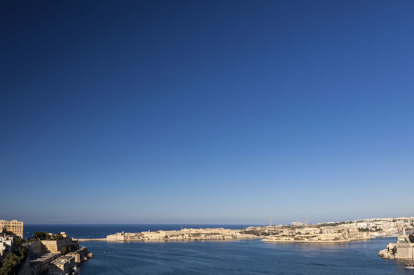 Valletta Harbour City Malta Valletta European Capital Of Culture 2018 Valletta,Malta Architecture Blue Building Exterior Built Structure City Cityscape Clear Sky Copy Space Day Grand Harbour Nature No People Outdoors Sea Sky Street Photography Travel Destinations Valletta View Into Land Water