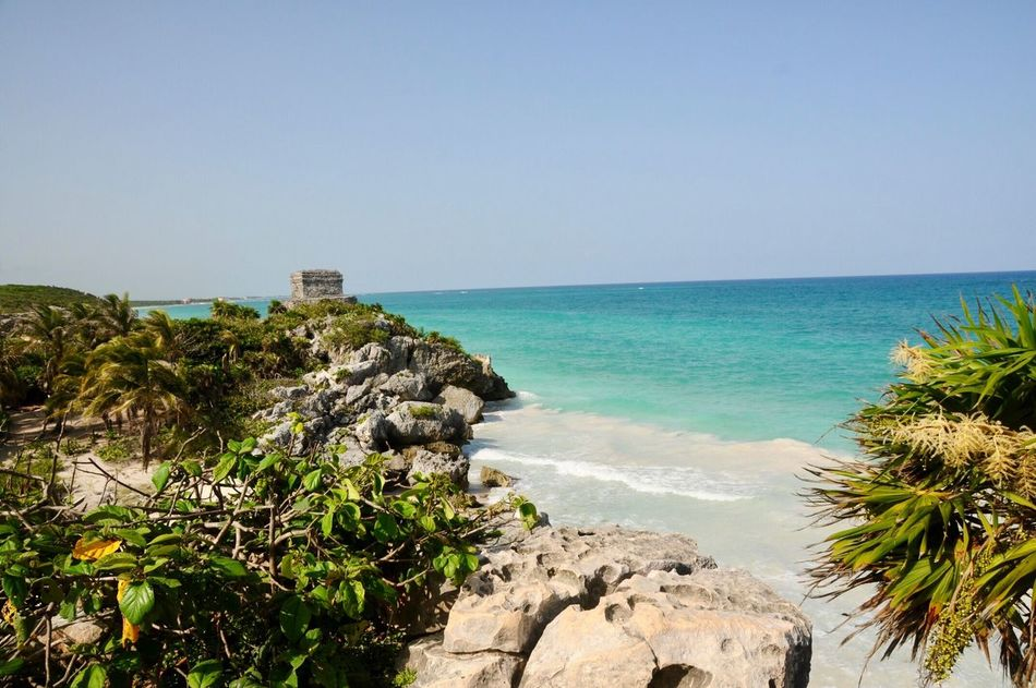 Tulum Beach Old Ruin Tulum , Rivera Maya. Tulum Beach Sea Clear Sky Copy Space Horizon Over Water Scenics Water Nature Blue Beauty In Nature Outdoors Rock - Object Built Structure Day No People Tranquility Architecture Sky Tourist Viajando Mexico