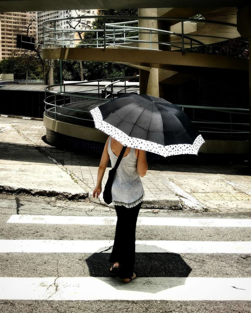 The City Light One Person Only Women Standing Sunlight Outdoors Adults Only Real People One Woman Only Day Adult People São Paulo Adults Only Women Lifestyles Umbrella Lady Umbrella