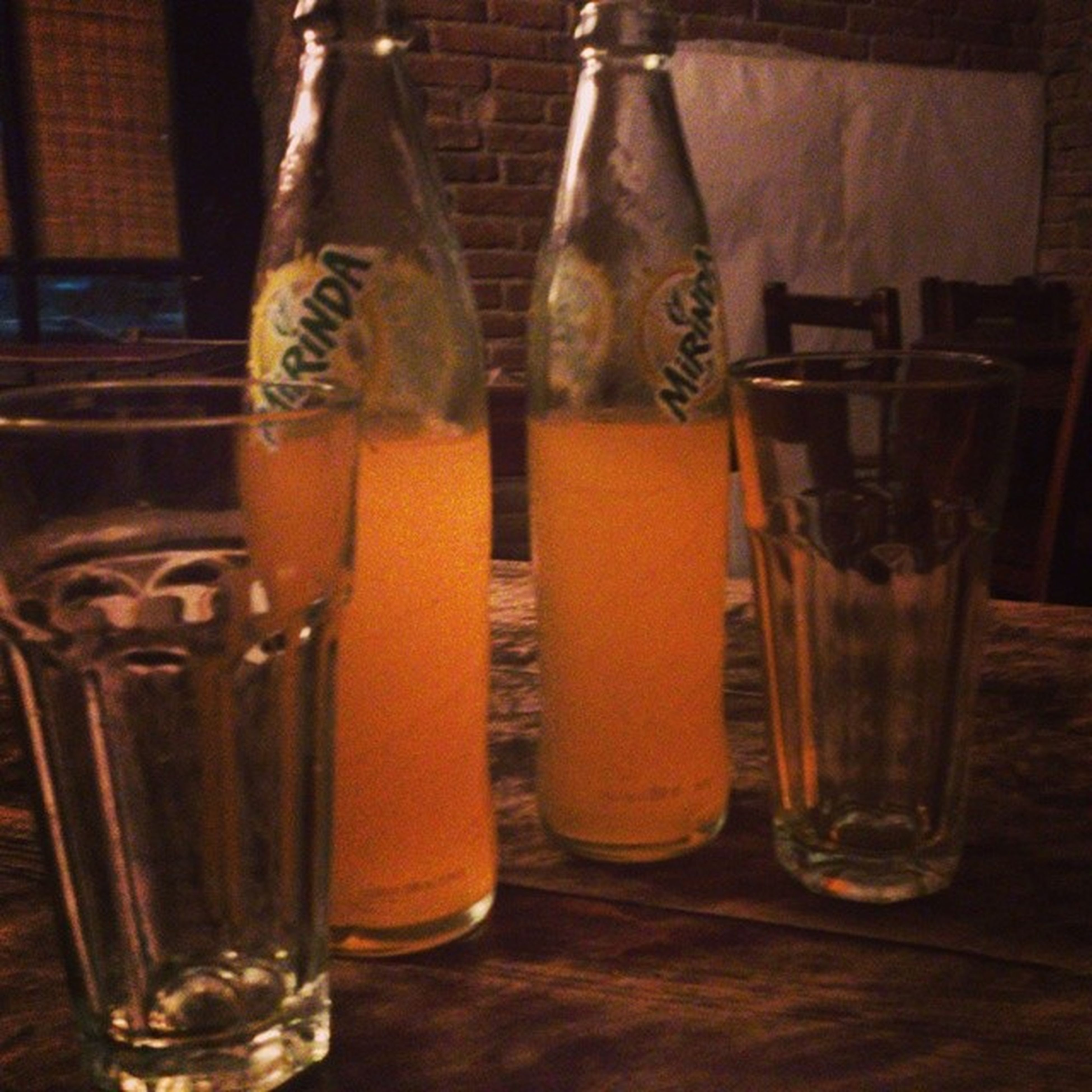 drink, food and drink, drinking glass, refreshment, table, indoors, still life, alcohol, freshness, glass - material, close-up, transparent, restaurant, focus on foreground, glass, beer glass, drinking straw, bottle, beer - alcohol, cocktail