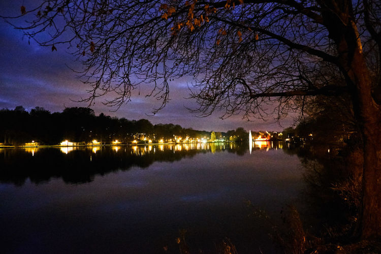 Nightscape by the lake Genval - Beauty In Nature Genval Idyllic Illuminated Lake Nature Night No People Outdoors Reflection Reflection Lake Scenics Sky Standing Water Sunset Tranquil Scene Tranquility Tree Water Waterfront