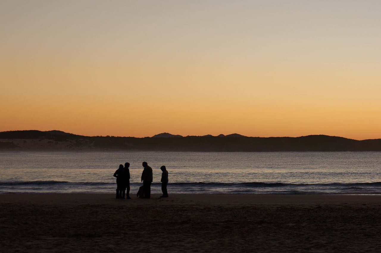 Sunset Beach Silhouette Nature Water Sand Beauty In Nature Togetherness Sea Scenics Real People Sky Leisure Activity Tranquil Scene Tranquility Outdoors Lifestyles Men Vacations Friendship