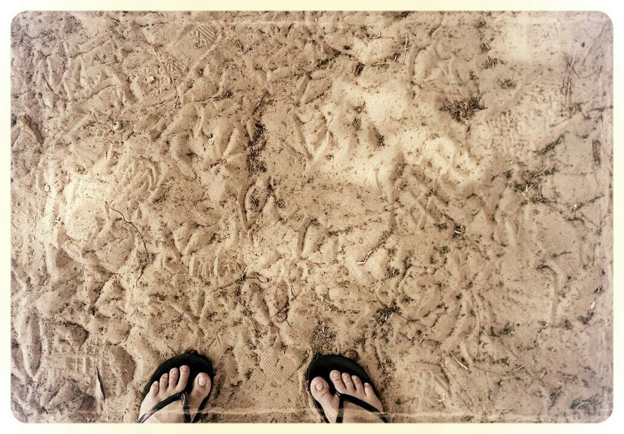 sand, low section, human leg, human body part, beach, directly above, high angle view, standing, one person, day, outdoors, close-up, adult, people, adults only