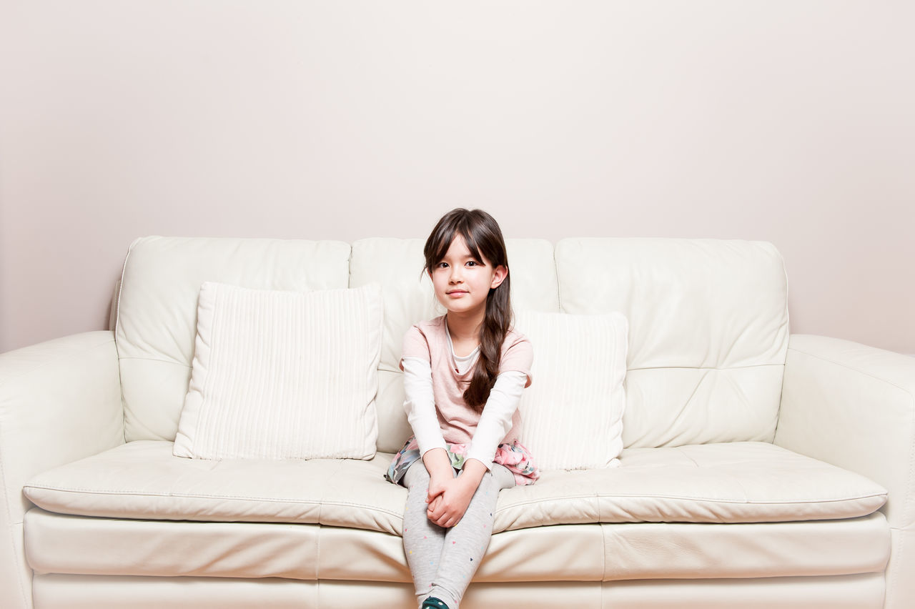 Beautiful stock photos of mädchen, sofa, one woman only, only women, one person