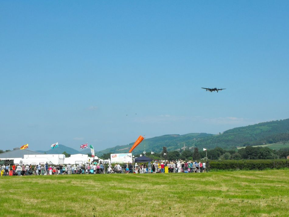 Coming into Landing - Touching Down Airplane Flying Air Vehicle Airshow Day Sky Outdoors Air Force Airport Runway Show Crowd Colorful Welshpool Wales Summer Plane Aircraft Military Flags Union Jack Welsh Dragon Festival Holiday Travel