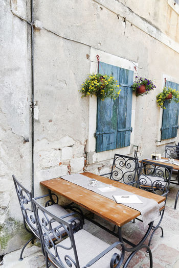 Antique Architecture Blue Chairs Croatia Day Dubrovnik No People Outdoors Pots Of Flowers Rustic Shutters Stone Wall Street Terrace Tables Windows