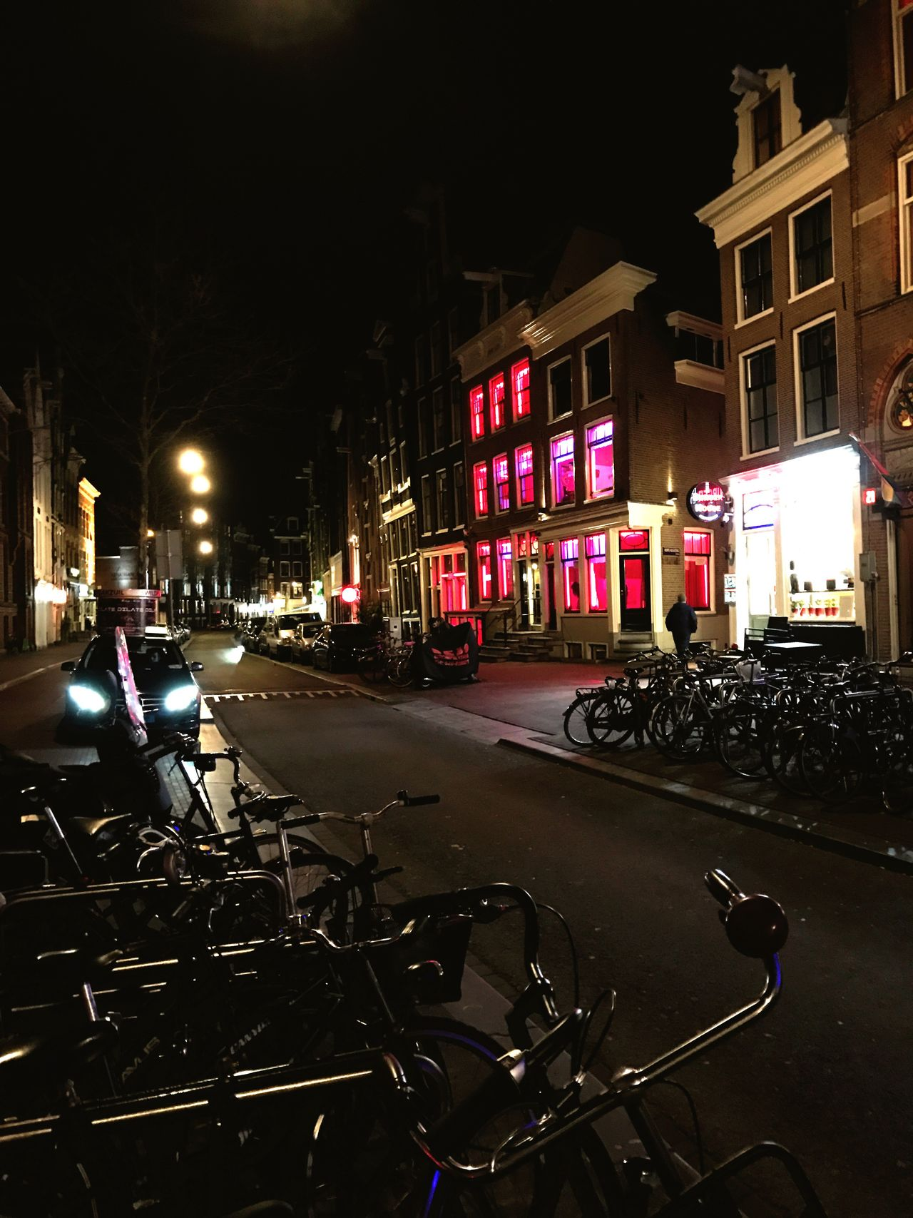 Illuminated City Night Transportation Street Building Exterior Architecture Built Structure Mode Of Transport City Street Travel Destinations Outdoors Land Vehicle Road No People Sky Red Light For Rent Amsterdam Amsterdamcity Amsterdam Centraal