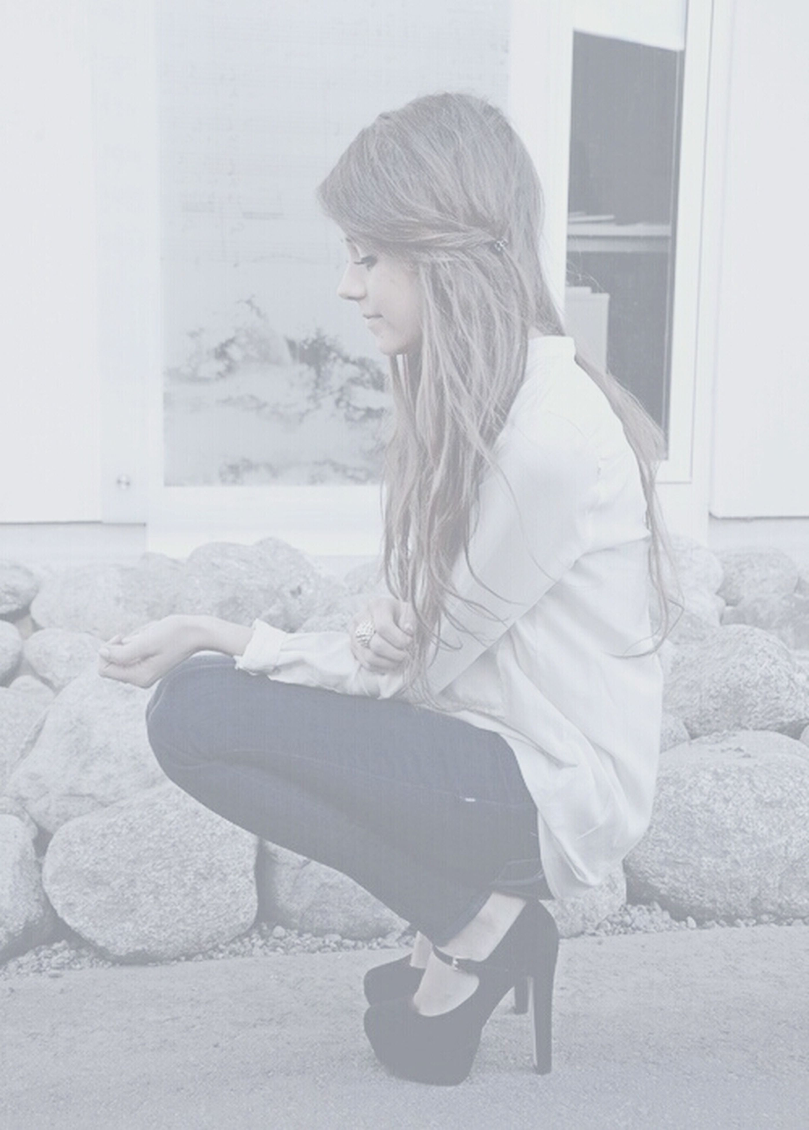 person, lifestyles, full length, casual clothing, young adult, young women, leisure activity, standing, side view, long hair, three quarter length, front view, wall - building feature, built structure, elementary age, childhood, looking away